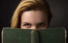 Thumb_suspense-woman-book-getty
