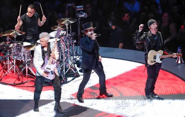 Larry Mullen Jr., Adam Clayton, Bono, and The Edge of the Irish rock band U2 perform during the \'Experience + Innocence\' tour at the United Center in Chicago on May 23, 2018.