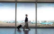 Thumb_mi_flying_airport_travel_suitcase_women_getty