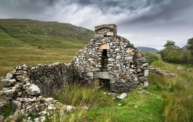 The ruins of a Famine cottage in Donegal, Ireland. this was one of many houses in an abandoned village in an isolated part of the mountains.