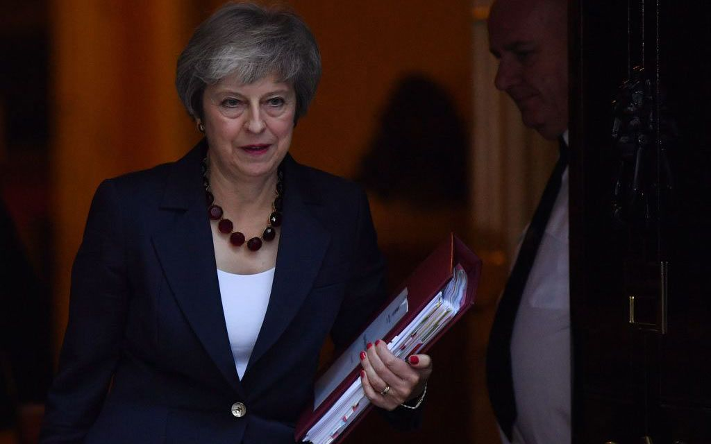 British Prime Minister receives backing for draft Brexit agreement that avoids Northern Ireland hard border