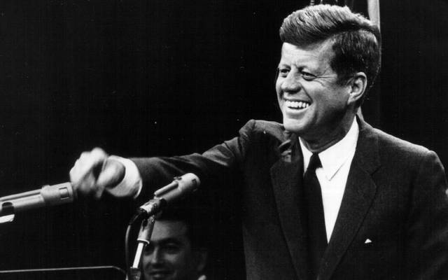 President John F. Kennedy laughs during a press conference August 9, 1963.