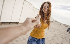 Thumb givign hands passing redhead getty