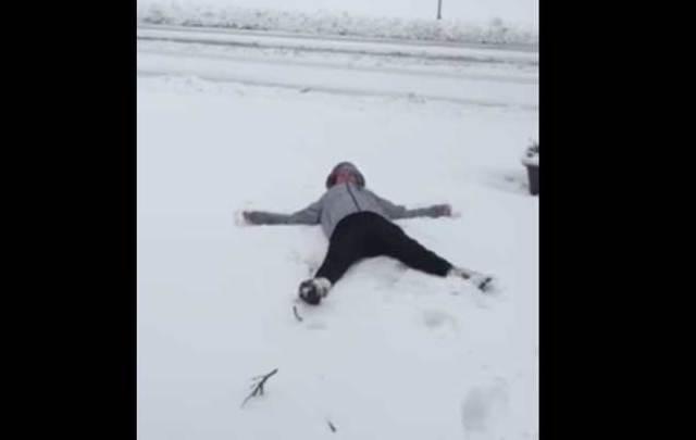 Irish woman attempts a snow angel.