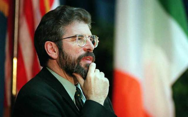 Sinn Fein President Gerry Adams flanked by the US and Irish flags in this photo dated March 12, 1998.