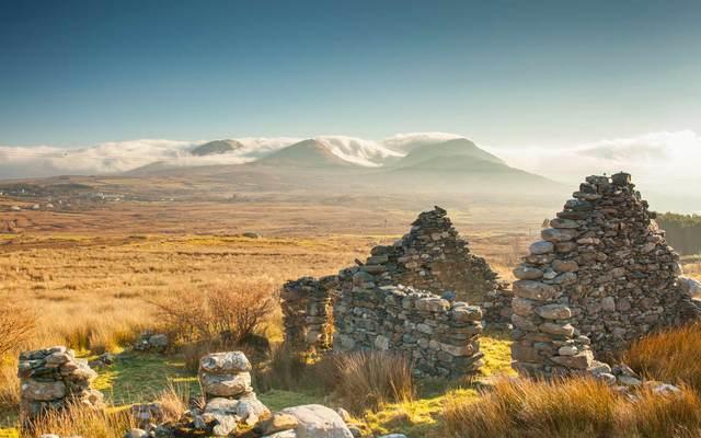 Old ruined stone cottage overlooks the Renvyle Peninsula in Connemara, West of Ireland.