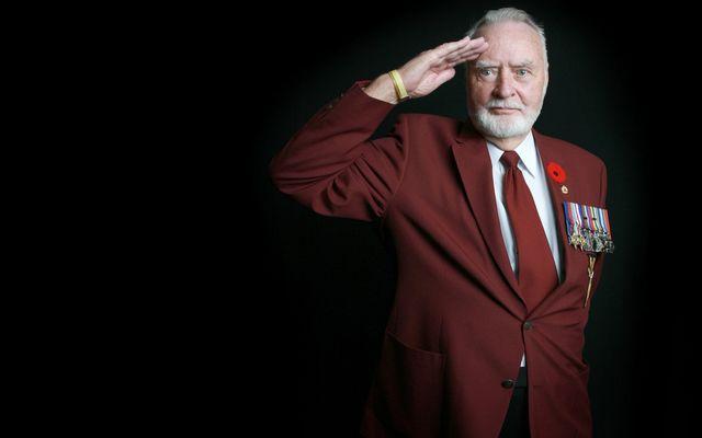WWII veteran salutes.