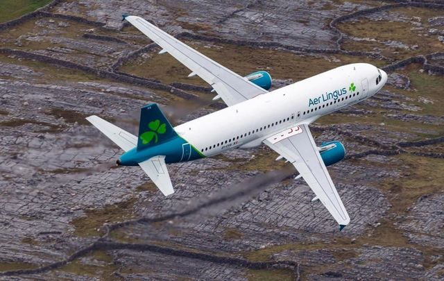 An Aer Lingus plane, with the new 2019 livery, flying over the Aran Islands, off Galway, en route to JKF airport in New York.