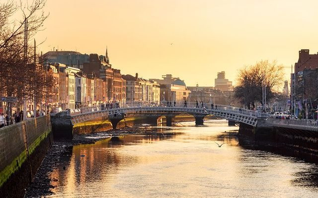 The Ha\' Penny Bridge, over the River Liffey, at the center of Dublin city.