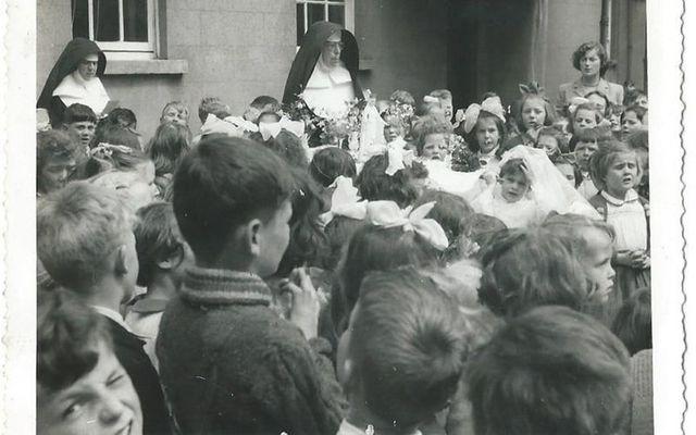 Catholic nuns running Jean Farrell\'s own schoolyard on her communion day.