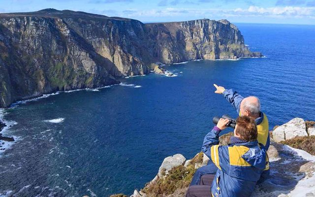 Senior Couple admires a beautiful landscape.Location is Ireland county Donegal