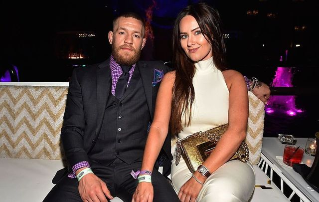 Mixed martial artist Conor McGregor (L) and Dee Devlin attend his birthday celebration at Intrigue Nightclub at Wynn Las Vegas early July 10, 2016, in Las Vegas, Nevada.