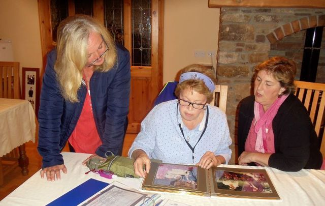 Denise (left) and Brid Fitzpatrick (right) share genealogy and family records with Kate at Glenraha B&B in Mullinavat, Co. Kilkenny.