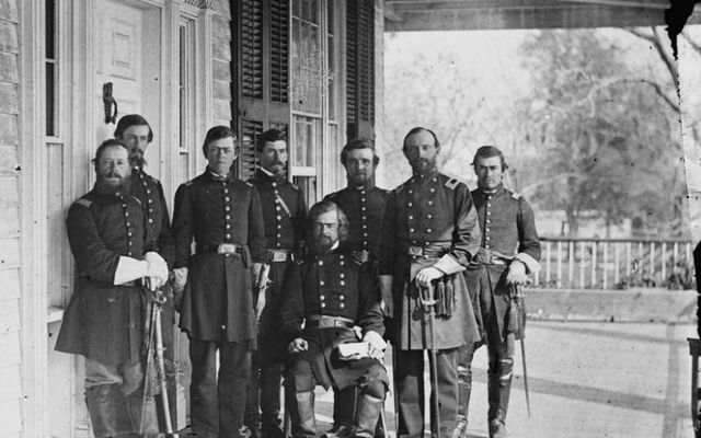 Timothy O\'Sullivan\'s photograph of Gen. Isaac Stevens (seated) and staff.