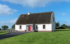 This stunning thatched cottage on the banks of the River Shannon is for sale