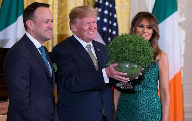 Prime Minister Leo Varadkar of Ireland, United States President Donald J. Trump, and first lady Melania Trump pose with a bowl of shamrocks presented by Varadkar to Trump during the Shamrock Bowl Presentation at the White House on March 15, 2018, in Washington, D.C.