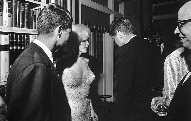 Cecil Stoughton\'s famous photograph of Marilyn Monroe, John F. Kennedy, and Robert F. Kennedy.