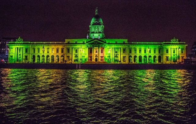 """Greening the City"": The Customs House, on the River Liffey, lit up for St. Patrick\'s Day."