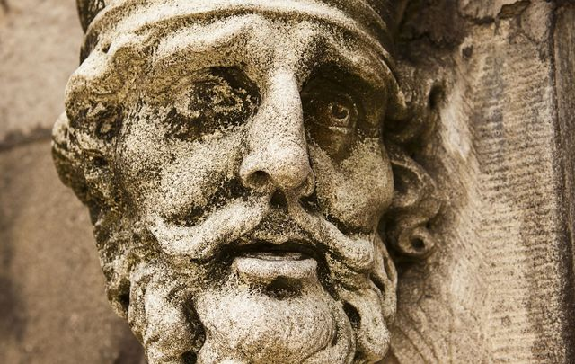 An old weathered statue of King Brian Boru of Ireland as seen on the outside of the Chapel Royal at the Dublin Castle.