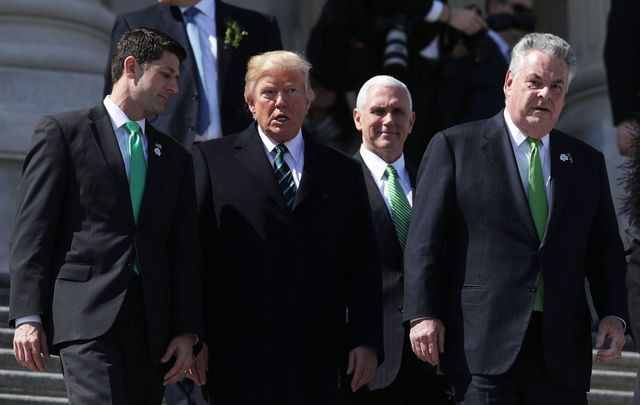 U.S. President Donald Trump (2nd L), former House Speaker Paul Ryan (R-WI) (L), Vice President Mike Pence (2nd R) and Rep. Peter King (R-NY) (R) walk down the House east front steps after the annual Friends of Ireland luncheon at the Capitol March 16, 2017 in Washington, DC.