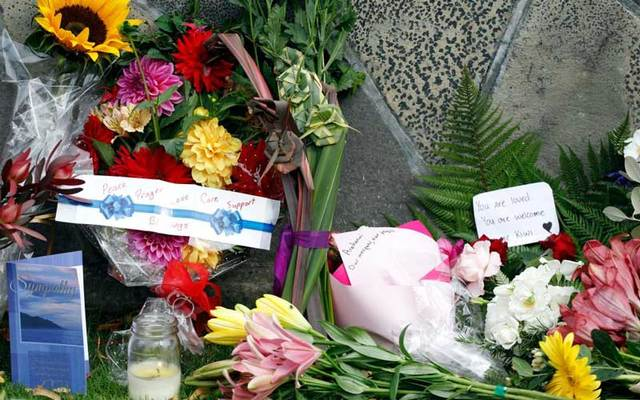 Flowers with messages for the victims of the mosque attacks are seen at the Botanical Garden in Christchurch on Saturday, March 16.