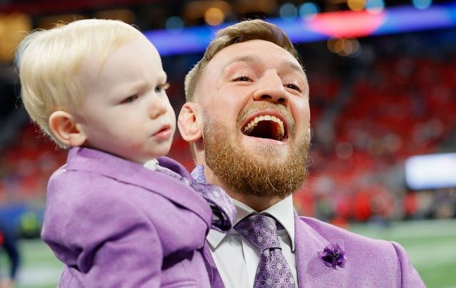 Conor McGregor with his son, Conor Jack McGregor Jr., on the field prior to Super Bowl LIII at Mercedes-Benz Stadium on February 3, 2019, in Atlanta, Georgia.