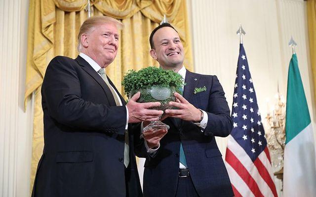 US President Donald Trump receives the traditional shamrock from Irish Leader Leo Varadkar on St. Patrick\'s Day 2019.