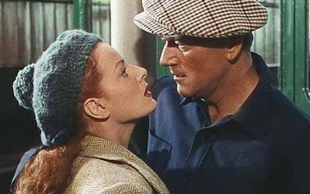 Maureen O\'Hara and John Wayne\'s famous embrace at the railway station in The Quiet Man.
