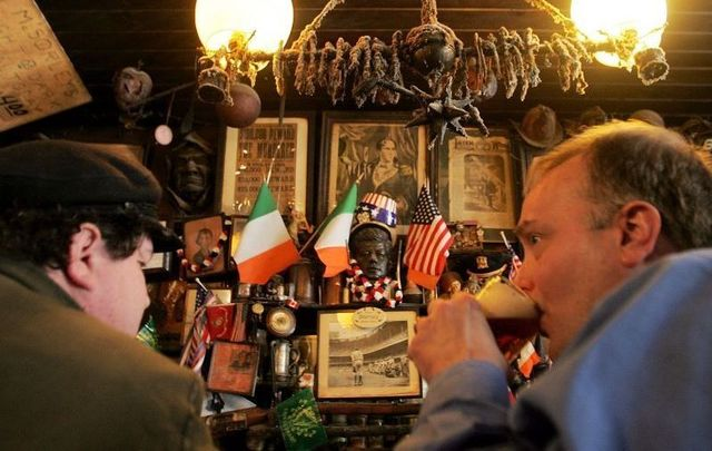 Patrons enjoy a beer in McSorley\'s Old Ale House in NYC