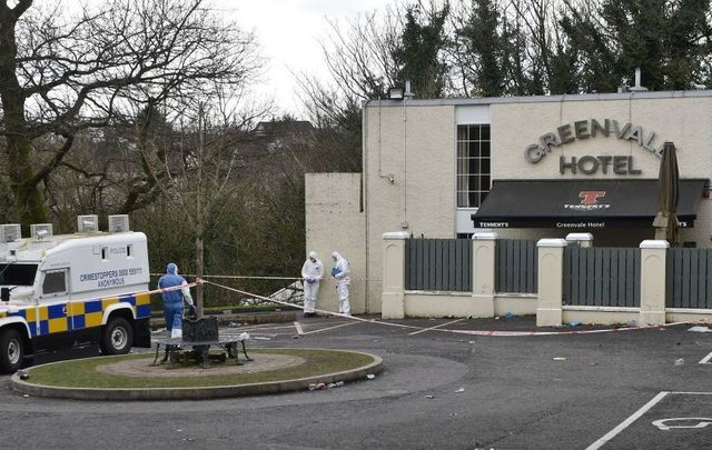 Police forensic officers attend the scene outside the Greenvale Hotel nightclub on March 18, 2019, in Cookstown, Northern Ireland.