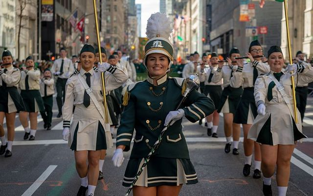 Cheerleaders marching in the New York St. Patrick\'s Day Parade 2019.