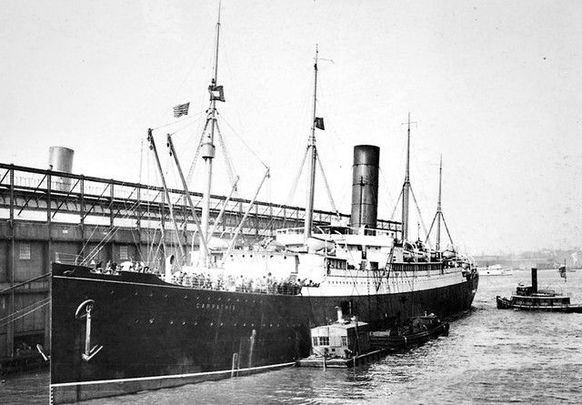 The RMS Carpathia docked at New York City in 1912 following the rescue of the survivors of the Titanic
