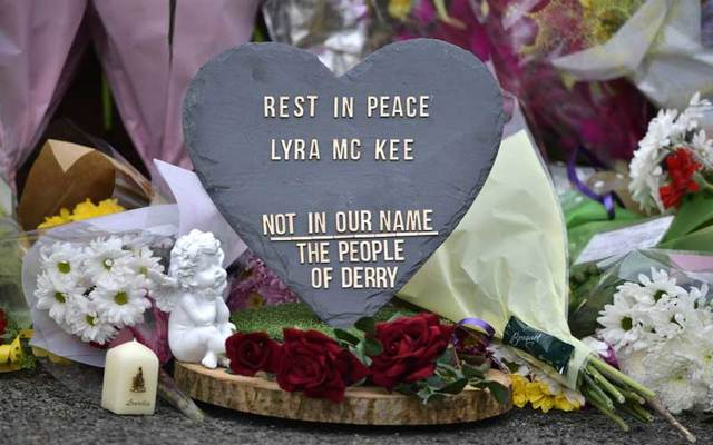 A plaque and flowers left in tribute to journalist Lyra McKee.