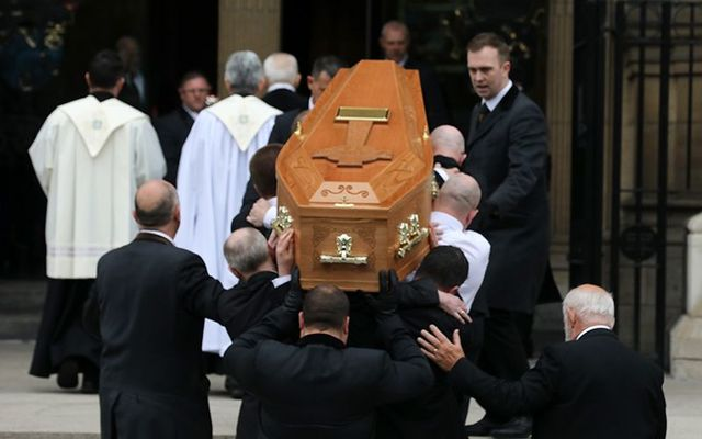 Lyra McKee\'s funeral being carried into St. Anne\'s cathedral, in Belfast.