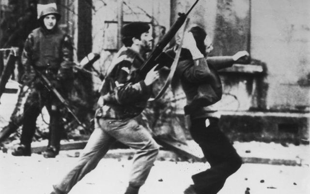 A British soldier and civil rights protester on Bloody Sunday.
