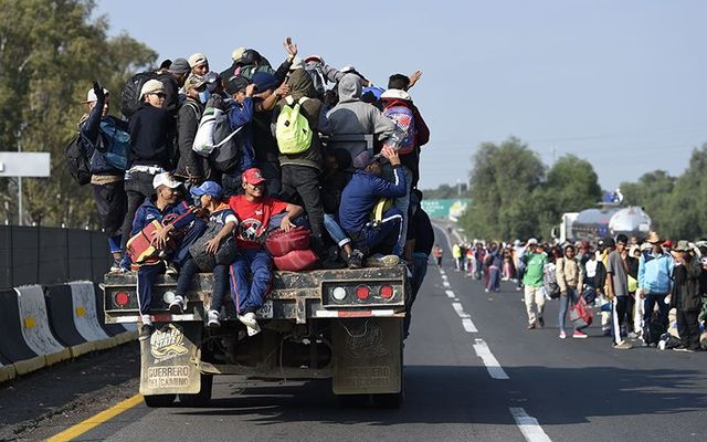 Immigrant caravan approaching the Mexican border to the United States.