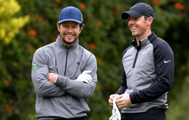 Actor Mark Wahlberg and Rory McIlroy of Northern Ireland laugh on the fourth tee during the Pro-Am at the Genesis Open on February 13, 2019, in Pacific Palisades, California.