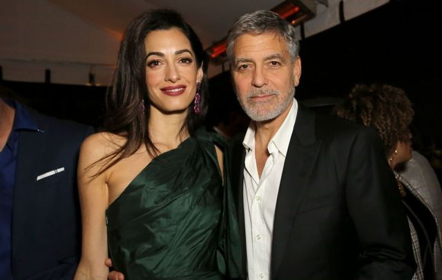 "Amal Clooney and George Clooney attend the premiere of Hulu\'s ""Catch-22\"" on May 07, 2019, in Hollywood, California."