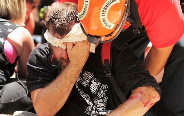 Rescue workers tend to a man injured in the violence during 2017\'s \'Unite the Right\' rally in Charlottesville.