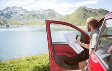 Thumb_mi_car_map_tourist_lake_mountain_getty
