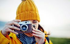 Thumb_woman_taking_picture_photographer_camera___getty