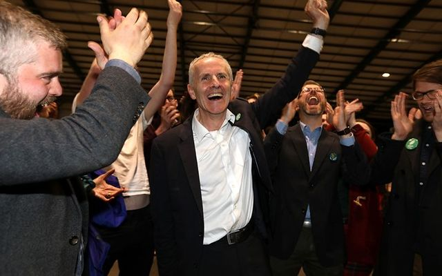 Ciaran Cuffe, Green Party Dublin candidate for Europe, celebrates his win at the election counting center, at the RDS, in Dublin.