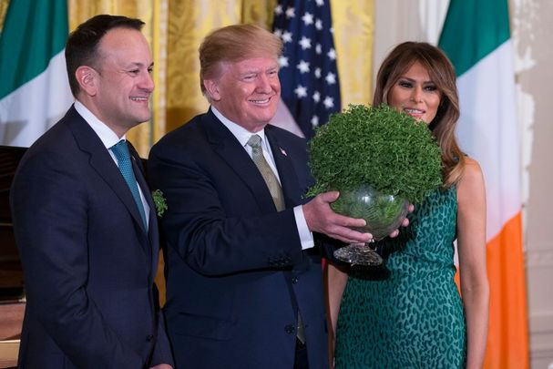 Irish Taoiseach Leo Varadkar presenting President Donald Trump with St Patrick\'s Day shamrock in the White House.