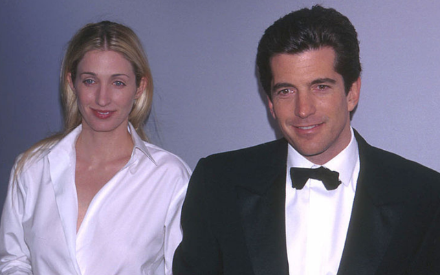 """John Kennedy Jr. with wife Carolyn Besset arrives at \""""Bright Night Whitney,\"""" a retrospective celebration of a century of American art at the Whitney Museum in New York City March 9, 1999."""