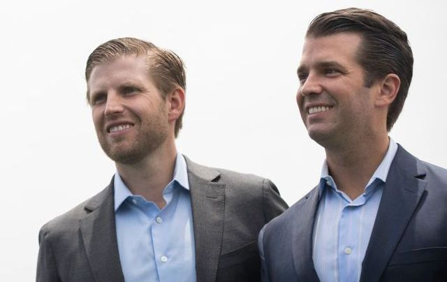 Eric Trump and Donald Trump Jr. attend a ribbon-cutting event for a new clubhouse at Trump Golf Links at Ferry Point, June 11, 2018, in The Bronx borough of New York City.