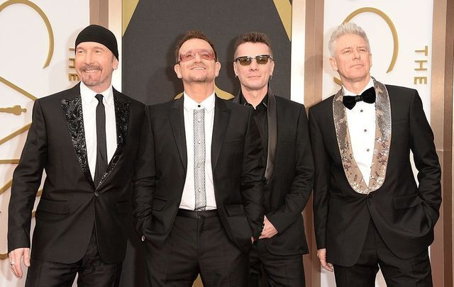 Musicians The Edge, Bono, Larry Mullen Jr. and Adam Clayton of U2 attend the Oscars held at Hollywood & Highland Center on March 2, 2014, in Hollywood, California.