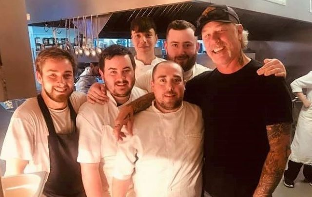 Metallica lead singer James Hetfield with some of the staff at Vaughan\'s Anchor Inn on Monday.