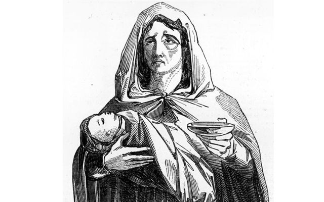 A woman begging with her child in Clonakilty, County Cork.