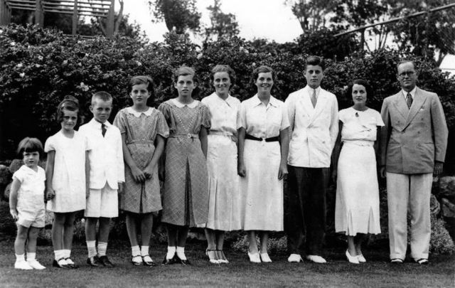 Joseph Patrick Kennedy, Sr and his wife Rose Kennedy (both far right) with eight of their nine children (L to R) Edward, Jeanne, Robert, Patricia, Eunice, Kathleen, Rosemary, and John in 1937.