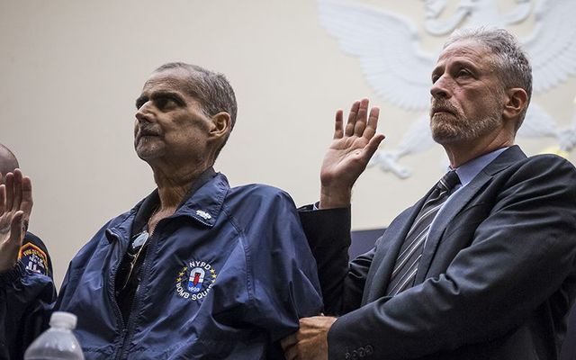 9/11: Lou Alvarez, a retired New York Police Department detective who has just entered hospice and Jon Stewart swear in to testify before the US government.